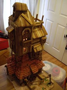 Wickedly creative edible craft. The Weasley's Burrow made out of gingerbread.