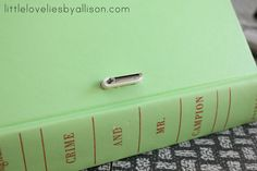 """Turn an old book into an Iphone dock, to help keep your bedside table looking """"classy"""". I love this idea!"""