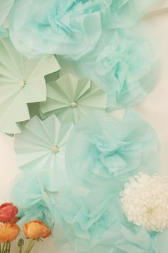 Mix of paper pinwheels and fabric pom poms
