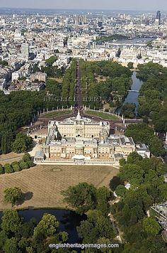 BUCKINGHAM PALACE - Aerial view of the Palace with The Mall, St James, Park Lake and the city beyond.