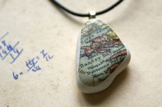 Cool idea for vacations.  A river rock, map, and modpodge.
