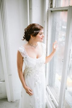 Gown by Claire Pettibone from Gabriella New York ~ Headpiece by Sara Gabriel. Photography by Arielle Doneson.