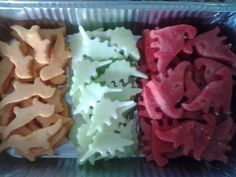 Watermelon, cantaloupe and honeydew cut into dinosaurs with cookie cutters! watermelon dinosaur, dinosaur food, dinosaur watermelon
