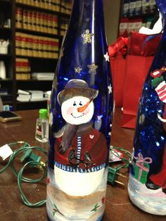 Snowman painted wine bottle with Christmas lights inside painted by Silvia (SAH)