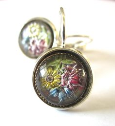Antique button earrings. 1800s 3-dimensional flowers under glass. Rare!