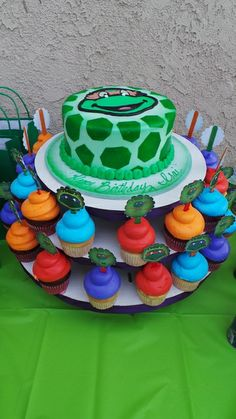 Colorful cake and cupcakes at a Teenage Mutant Ninja Turtles Birthday Party! See more party ideas at CatchMyParty!