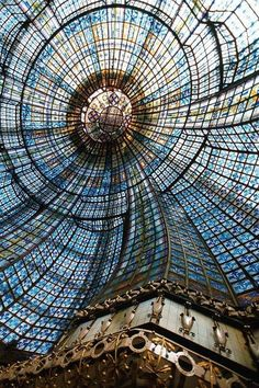 This elaborate stained-glass cupola dome inside Magasins du Printemps, Paris, France is located above the main restaurant in the store. Installed in 1923, it is composed of 3,185 individual pieces of stained glass.
