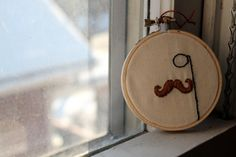 Mustache and Monocle Embroidery Hoop Decor