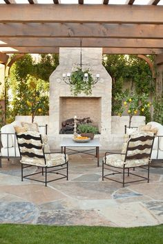 Pergola with outdoor fireplace.