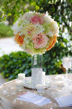 Cylinder vase centerpiece - via Hobby Lobby