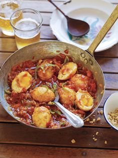 Golden Egg Curry: Eggs are first boiled, then peeled and fried in medium-hot oil. The smooth whites blister and firm up into an attractive golden crust. Only then are the eggs cut into half and added to a sauce—here, a light tomato-based sauce that's mildly chile hot. Serve with rice or bread, a crisp salad, or a condiment. #burma #egg #curry