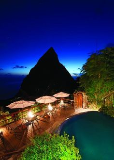 Ladera, St. Lucia  Caribbean A thousand feet below, an intensely blue Caribbean Sea dashes against the volcanic Piton Mountains