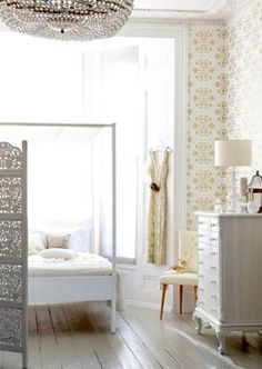 white and gold bedroom. gorgeous floors, wallpaper, bed and antique beaded chandelier
