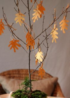 Have holiday guests share what they are thankful for on a DIY giving tree centerpiece.