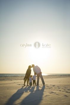 Love this beach silhouette of family