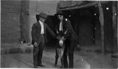 Two men holding a donkey, from Center of Southwest Studies, Fort Lewis College, Durango, CO