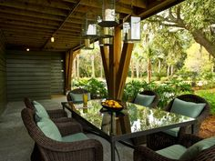 The romance of candlelight elevates the dining experience in this casual gathering area.  http://www.hgtv.com/dream-home/hgtv-dream-home-2013-side-yard-pictures/pictures/page-5.html?soc=dhpp