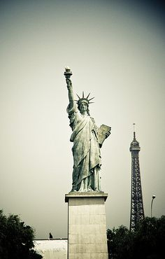 Statue of Liberty near La Seine in Paris, France and not too far from the Eiffel Tower! (p.s: Thanks Carla Siqueira for this beautiful shot!)