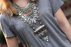 Tee and statement necklace.