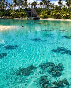 Turqoise waters of Bora Bora lagoon in French Polynesia.