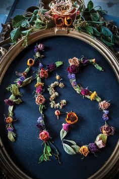 Dried flower monogram. Photographed by Geoff L. Johnson.