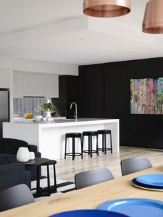 House & Apartment: ALH Resident, Excellent Home Redecoration by Mim Design. Elegant White Kitchen Design Towards Black Wall