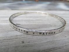 Personalized custom thick sterling silver bangle, hand stamped with your words, inspirational quote, dates, or childrens names by JoDeneMoneuseJewelry