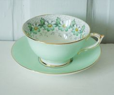 Stunning Minty Green with Daisies Teacup and Saucer. $34.00, via Etsy.