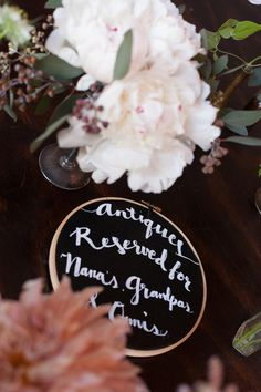 """chalkboard"" embroidery hoops, photo by Zaugh Photography, styling by Sweet Emilia Jane http://ruffledblog.com/huron-substation-wedding #weddingideas #signs #signage"