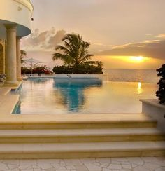 """Beach side infinity pool  ...An infinity edge pool (also named negative edge, zero edge, infinity pool, disappearing edge, or vanishing edge pool) is a swimming or reflecting pool that produces a visual effect of water extending to the horizon, vanishing, or extending to """"infinity."""""""