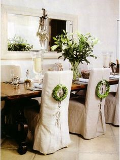 Pretty chair covers with wreaths.