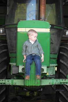 Boy's 3rd birthday photo shoot down on the farm. Tractor, country, boots, John Deere picture.