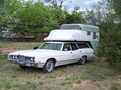 1971 Ford Station Wagon with unique slip-on camper.