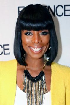 Tasha Smith has made this bangs-and-bob combo her signature hairstyle and she wears it very well.