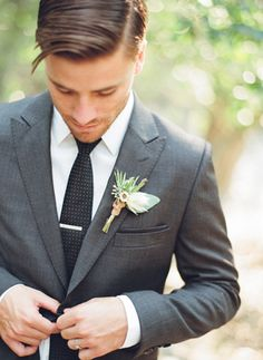 Love the gray suit with black dot tie combo.