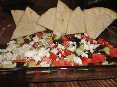 hummus dip= layered hummus tomatoes, cucumbers, olives, feta + pita bread :)