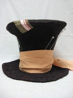 free pattern & tutorial on making a mad hatter hat.  Could make smaller version for a doll.  Could also use same idea for a top hat etc.