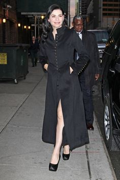 Julianna Margulies of CBS's 'The Good Wife'' shows some leg under her long coat, as she heads into 'The Late Show with David Letterman' in New York City