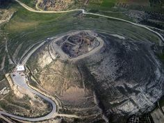 Herodium from above. Herodium or Herodionis a truncated cone-shaped hill, located  (7.5 mi) south of Jerusalem and (3.1 mi) southeast of Bethlehem, in the Judean desert (the West Bank). Herod the Great built a fortress, a palace, and a small town in Herodium, between 23 and 15 BCE, and is believed to have been buried there. Herodium is (2,487 ft) above sea level, the highest peak in the Judean desert. holi land, biblic archaeolog, ancient, biblic place, palaces, national parks, israel, the great, deserts