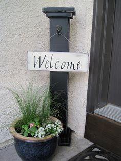 For the front porch - DIY Interchangeable Welcome Sign - made with 4x4 and 1x6 wood. Seasonal signs would be so fun to make and change out.