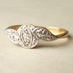 Art Deco Winged Diamond Platinum and 18K Gold Antique Ring. Etsy. $328.00.