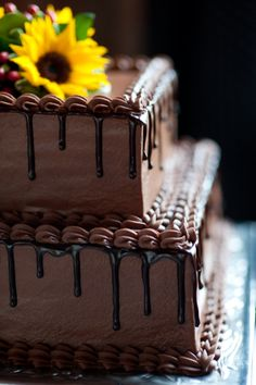 Thinking of doing a chocolate wedding cake too. This would be pretty with some roses on top instead of sunflowers. chocolate rose cake, chocol cake, chocolate grooms cake, pretty chocolate cake, chocolate wedding cakes, groom cake, chocolate cakes, cake wedding chocolate, wedding grooms cake