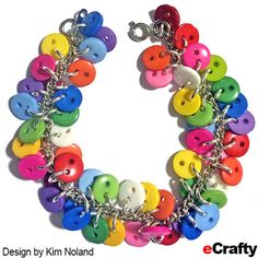 DIY Chakra Rainbow Button Charm Bracelet Recipe from eCrafty.com Supplies you'll need to make the bracelet: SKU 1063B  Rainbow Mix Buttons 9mm (450pc per bag ~ lots!) SKU 1501W  6mm x 1mm Silver Plated Jump Rings SKU 1198D 1 Starter Chain Bracelet Base, silver plated, 7″ #ecrafty #diybracelet #diyjewelry #summercrafts #campcrafts #buttoncrafts #buttons #rainbowjewelry #craftsupplies #beads
