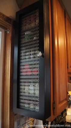Spice rack cabinet on end of upper cabinet. Nice and organized makes it easy to find.