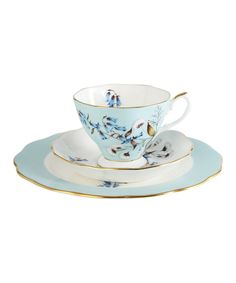 Royal Albert 1950 Festival Three Piece Set £40.00  features a dessert plate, teacup and tea saucer decorated with typically English flowers such as blue harebells, daffodils and snowdrops, on a pale blue background accented with a 9-carat gold edging  Each piece in the collection is decorated using a pattern and design representing some of the most iconic styles and colours of each decade.