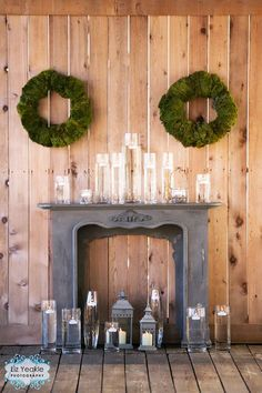 Shabby Chic Fireplace Mantel Wedding Backdrop with Floating Candles and Moss Wreaths by James Hurley Designs.