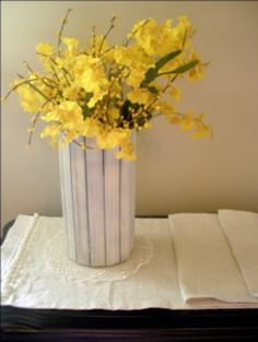 Formula Can + Paint Sticks = cute vase. Love this one.