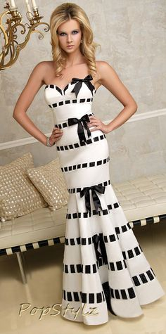 I REALLY REALLY want this!!!!!! (And somewhere to wear it to) Terani Black & White Mermaid Gown