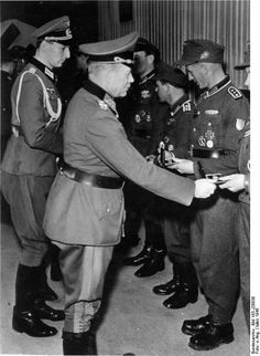 Shortly before the fall of Nazi Germany, Gen. Heinz Guderian presents awards to German soldiers, March 1945.
