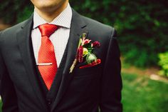 red tie groom, photo by Mullers Photography http://ruffledblog.com/luciles-old-market-wedding #grooms #suits